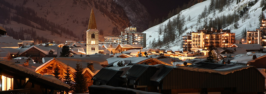 Val-Isere village at night with snow